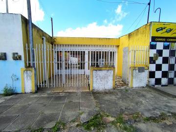 CASA COMERCIALCOM VARANDA,SALA DE ESTAR E JANTAR 3 QUARTOS SENDO 01 SUITE, WC SOCIAL, COZINHA, AREA DE SERVIÇO, QUINTAL.  ANEXO COM SALÃO E WC.